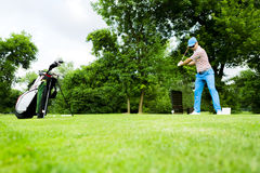 Golfer getting ready to hit the drive Royalty Free Stock Photography
