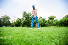 Golfer getting ready to take a shot Royalty Free Stock Image