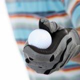 Golfer giving golf ball Stock Photography