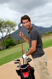 Golfer on glof course. Man standing on golf course with equipmant Royalty Free Stock Photos