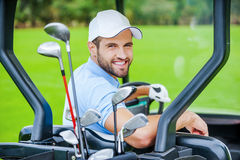 Golfer in golf cart. Royalty Free Stock Images