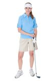 Golfer with a golf club Royalty Free Stock Images