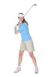 Golfer with a golf club Royalty Free Stock Photos
