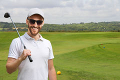 Golfer with golf club Royalty Free Stock Photo