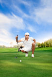 Golfer on golf course. Looking at the distance the ball from the hole Stock Images