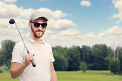 Golfer at golf course Royalty Free Stock Photo