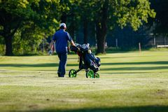 Belgrade, Serbia - June 1, 2019: Golfer with equipment on the golf course. Golfer on the golf course, senior golfer on recreational tour royalty free stock photo