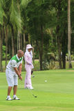 Golfer on golf course in Thailand Stock Images