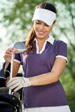 Golfer with golf equipment. Female golfer with golf equipment Stock Images