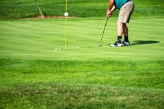 Golfer, golf player, on the green, mature male, not recognizable, copyspace stock photography