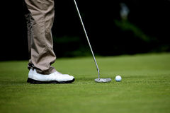 Golfer on green Royalty Free Stock Photo