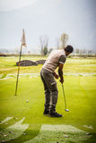 Golfer on the green Stock Photography