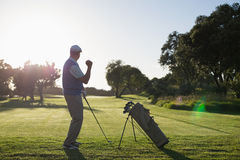 Golfer happy with his shot Royalty Free Stock Photos