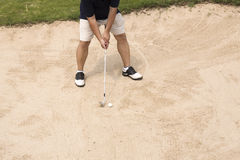 Golfer hit ball on sand trap Stock Images