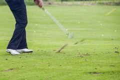 Golfer hits ball - impact Royalty Free Stock Photography
