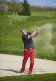 Golfer hitting a ball in the bunker Stock Photo
