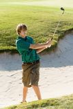 Golfer Hitting Golf Ball Out Of A Sand Trap Stock Image