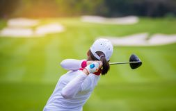 Golfer hitting golf to hole at golf course. Golfer hitting golf to hole on green  grass at golf course in competition Stock Image