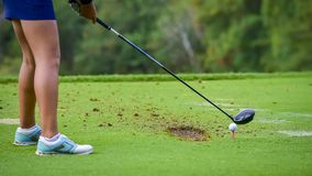 Golfer hitting golf to hole at golf course stock images