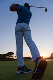 Golfer hitting long shot Royalty Free Stock Image