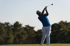 Golfer hitting long shot Royalty Free Stock Photo