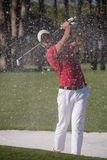 Golfer hitting a sand bunker shot Royalty Free Stock Images