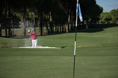 Golfer hitting a sand bunker shot Stock Images
