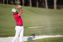 Golfer hitting a sand bunker shot Stock Photos
