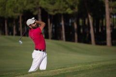Golfer hitting a sand bunker shot Stock Photo