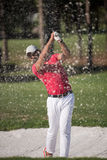 Golfer hitting a sand bunker shot Royalty Free Stock Image