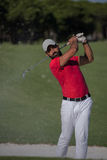 Golfer hitting a sand bunker shot. Golf player shot ball from sand bunker at course Royalty Free Stock Image