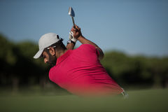 Golfer hitting a sand bunker shot. Golf player shot ball from sand bunker at course Stock Photo