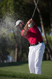 Golfer hitting a sand bunker shot. Golf player shot ball from sand bunker at course Stock Photos