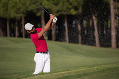 Golfer hitting a sand bunker shot Stock Photo