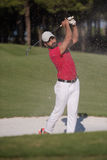 Golfer hitting a sand bunker shot Stock Photography