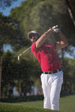 Golfer hitting a sand bunker shot. Golf player shot ball from sand bunker at course Stock Image