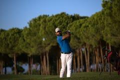 Golfer hitting a sand bunker shot on sunset Royalty Free Stock Photography