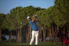 Golfer hitting a sand bunker shot on sunset Royalty Free Stock Photo