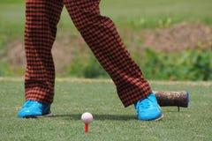 Golfer hitting shooting a golf Stock Photography