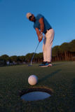 Golfer  hitting shot at golf course Royalty Free Stock Photo