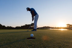 Golfer  hitting shot at golf course Stock Images