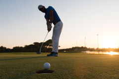 Golfer  hitting shot at golf course Royalty Free Stock Photography