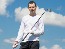 Golfer holding balls in hand Royalty Free Stock Photography