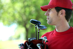 Golfer holding golf bag Royalty Free Stock Photos