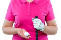 Golfer holding a golf club and ball at chest level Stock Photos