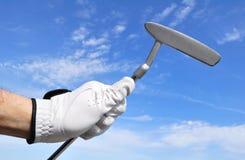 Golfer Holding a Putter. Golfer Wearing a Golf Golf Holding a Putter Royalty Free Stock Photos