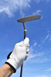 Golfer Holding a Putter. Golfer Wearing a Golf Golf Holding a Putter Royalty Free Stock Photography