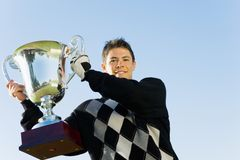 Golfer holding trophy Royalty Free Stock Image