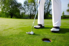 Golfer on the hole II. Golfer putting on the green Royalty Free Stock Photo