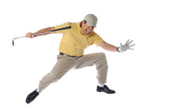 Golfer jumpinp. Golfer jumping and celebrating isolated on a white background Royalty Free Stock Photo